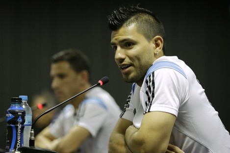 Argentina's Sergio Aguero, right, speaks during a news conference next to teammate Maxi Rodriguez.