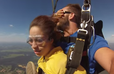 Skydiving instructor gets hit in the face with a shoe mid-air