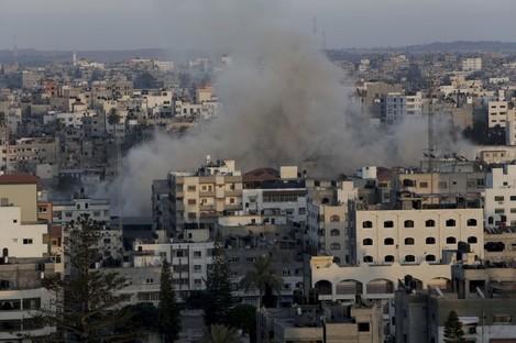 Smoke rises following an Israeli strike on Gaza Strip, Friday, July 11, 2014.