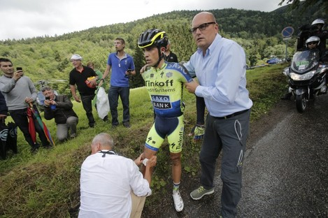 Contador receiving treatment yesterday.