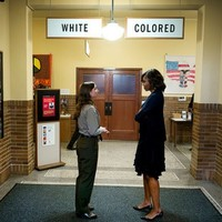 This poignant Michelle Obama photo perfectly captures 60 years of American history