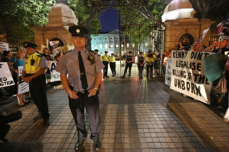 Gardaí between pro-choice and pro-life demonstrators outside Leinster House on the night of 10 July 2013 as TDs debated abortion until 5am.