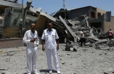 NATO bombs Gaddafi's compound while son says elections are possible