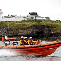 Man brought to hospital by helicopter after falling from cliffs