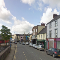An 84-year-old woman has died after being hit by a lorry, a man has been arrested