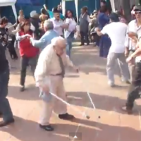 Crutch-wielding grandpa busts it out on the dancefloor