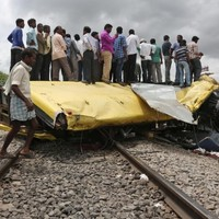 At least 19 dead after train crashes into school bus in India