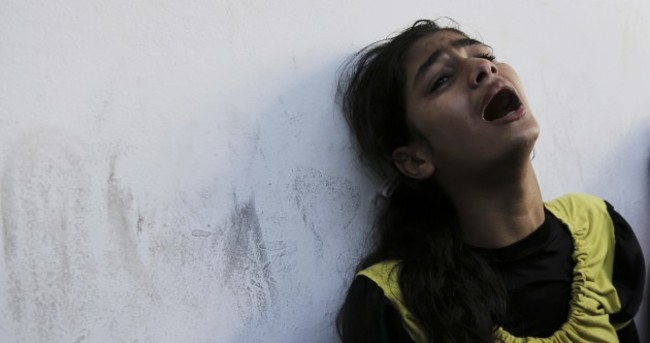 Israeli shell hits UN school in Gaza killing 15 people, including UN staff
