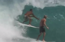 Angry surfer tackles another dude who drops in on his wave