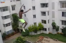 Guy jumps off five-storey building into swimming pool