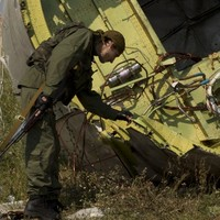Downing of flight MH17 'may amount to a war crime'