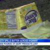 Truck crash coats US highway in butter