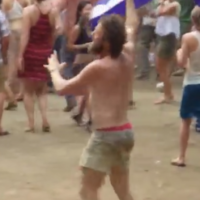 This man dancing joyously at a festival is the happiest person in the world