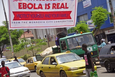 A banner reading 'Ebola is real, Protect yourself and your family', warns people of the Ebola virus in Monrovia, Liberia.