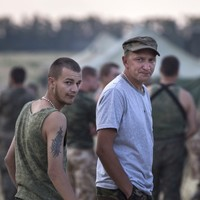 Ukraine negotiates return of soldiers 'forced to retreat' into Russia