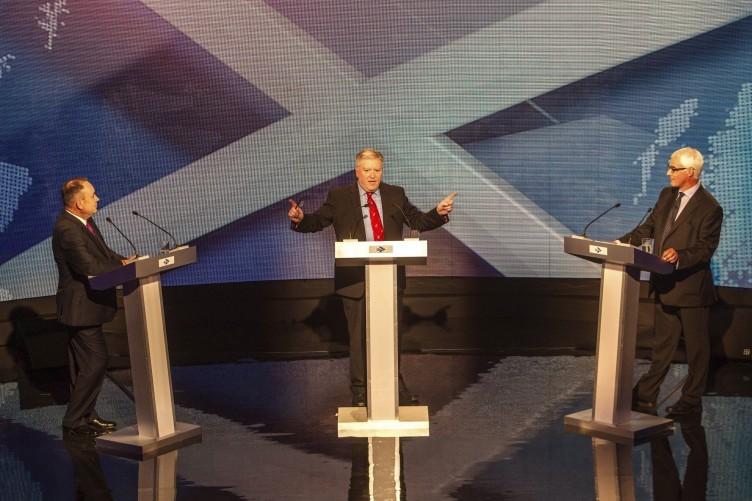 Alex Salmond (l), Alistair Darling (r) and moderator Bernard Ponsonby (c) during the debate tonight.