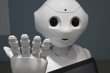 """Humanoid Robot """"Pepper"""" is displayed at SoftBank Mobile shop in Tokyo, Friday, June 6, 2014."""