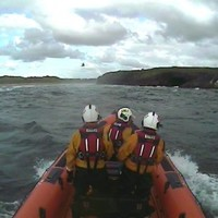 Family of four trapped on rocks winched to safety by helicopter