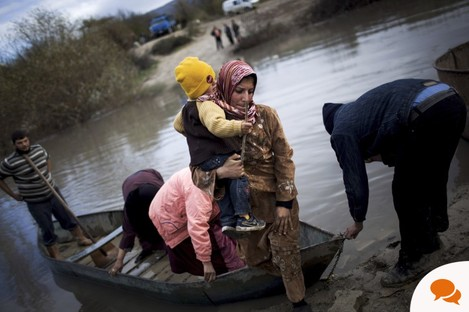 Syrian refugees crossing from Syria to Turkey.