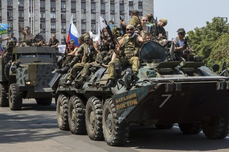 Pro-Russian rebels ride their APC and truck as they celebrate Paratroopers' Day in the city of Donetsk last week.