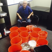 Insurer pays off lawsuit with thousands in buckets of coins