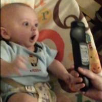 Baby boy freaks out way too much over a simple TV remote