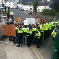 Why are people protesting against a bridge being built in Kilkenny?