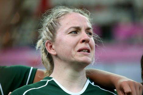 A tearful Niamh Briggs in Ireland's post-match huddle.
