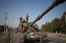 Russian armoured vehicles seen near Ukraine aid trucks