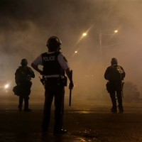Police fire smoke and tear gas at defiant Ferguson protesters