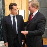 Kenny meets Sarkozy as tax issue shifts focus