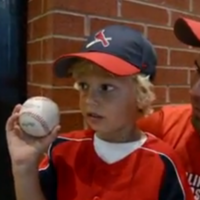 Little boy throws Dad's foul ball back onto baseball field