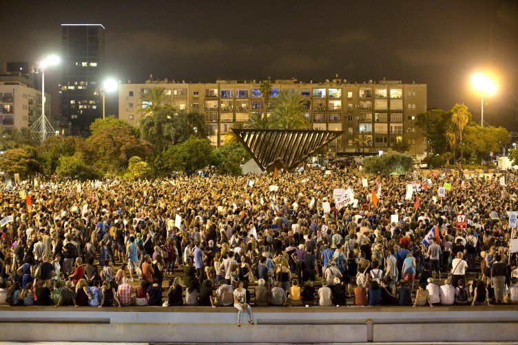 Israeli activists gather for pro-peace rally against a military solution to the Israeli Palestinian conflict in Tel Aviv, Israel on Saturday, 16 August 2014.