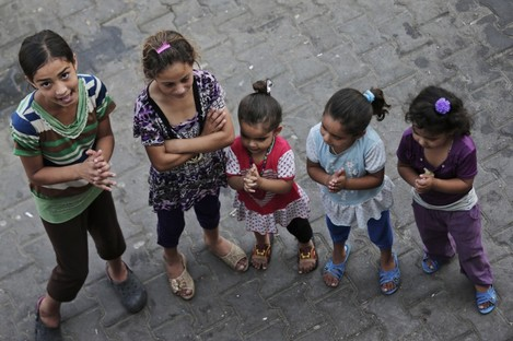 Displaced Palestinian children participate in a play session at a U.N. school where they had sought refuge along with their families during the war, in Gaza City.