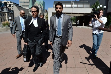 Khurram Syed Sher (centre) leaves court today after being found not guilty.