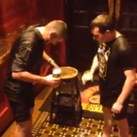 Two lads do the ice bucket challenge while having pints in Temple Bar