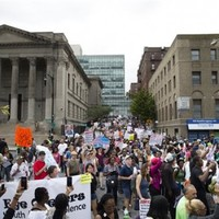 'We're here to deal with the rotten apples': Thousands rally over chokehold death in New York