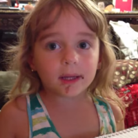Little girl tries to convince mam she didn't eat a doughnut...with chocolate all over her face