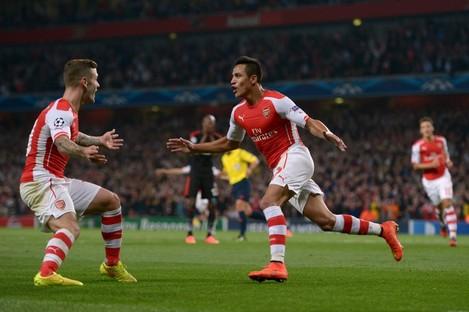 Sanchez celebrates his goal last night.