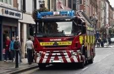 Three injured in crash between fire engine and car