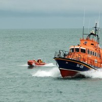 RNLI tow pleasure boat that was stuck on rope back to harbour