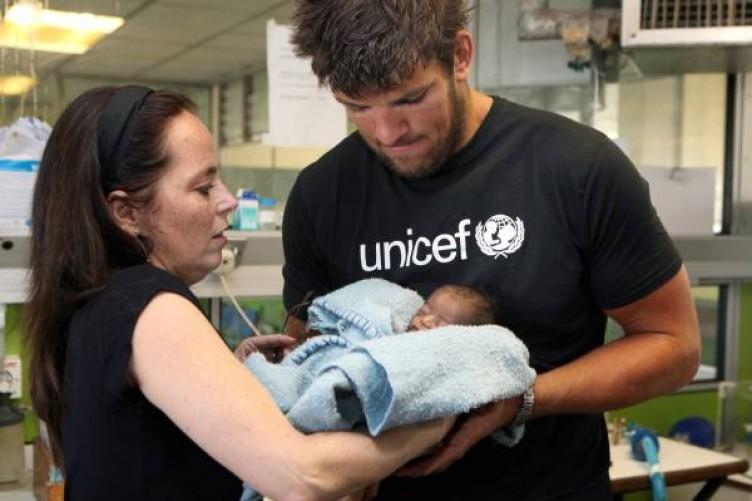 UNICEF Ireland Ambassador and Irish rugby star Donncha O'Callaghan and UNICEF Ireland Executive Director Melanie Verwoerd visit the neo-natal ward of Harare General Hospital, Zimbabwe.
