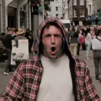 Guy walks through Galway singing death metal to bemused shoppers