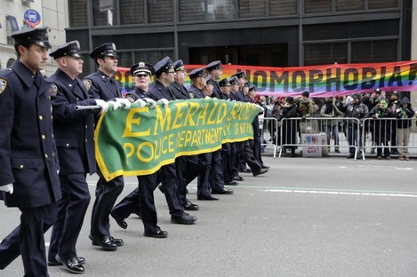 """Protesters at last March's New York St Patrick's Day parade hold a banner reading """"Boycott Homophobia."""""""