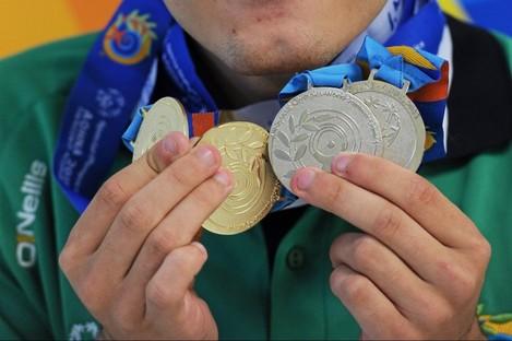 John Michael Gannon with his medal haul