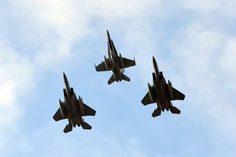 One Canadian and two US jets take part in a flypast over the Nato 2014 Summit in South Wales.