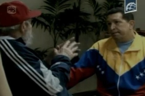 Where's Hugo? He's deep in conversation with Fidel Castro.