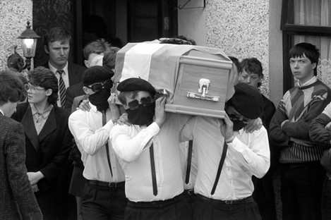 IRA men carry the coffin of Tony Gormley who was killed in the gunfight.