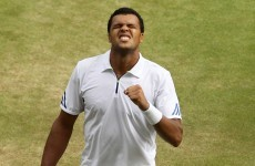 Tsonga stuns Federer, as Djokovic topples Tomic in Wimbledon quarters