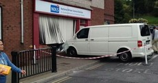 Van rolls down hill... and into a driving licence office
